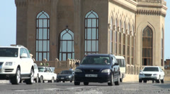 Traffic drives past Azeri mosque Stock Footage