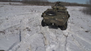 Stock Video Footage of military, LAV3 armoured fighting vehicle moves alongside, follow shot