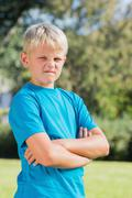 Young boy looking angry - stock photo