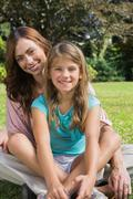 Stock Photo of Happy mother and daughter on the grass