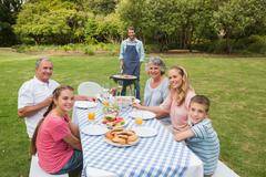 Stock Photo of Smiling extended family having a barbecue