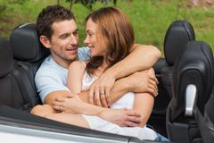 Stock Photo of Couple in love cuddling in the backseat
