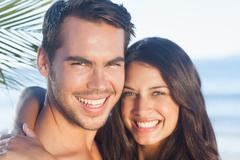 Cheerful loving couple having holidays - stock photo