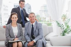 Stock Photo of Smiling partners posing while having a meeting