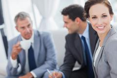 Cheerful businesswoman having a meeting with her colleagues - stock photo