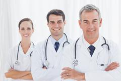 Smiling doctors posing together - stock photo