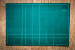 Cutting mats on the wood background Stock Photos