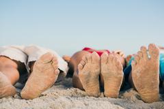 Stock Photo of Picture of friends feet lying together