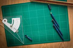 Cutting mats , pen drawings , adjust angle tool , scale ruler  on the wood ba Stock Photos