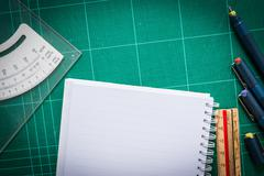 cutting mats , paper , pen drawings , adjust angle tool , scale ruler  on the - stock photo