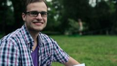 Happy young student in the park HD Stock Footage