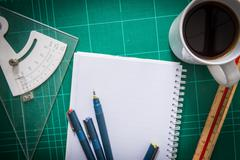 cutting mats , paper , pen drawings , adjust angle tool , scale ruler , coffe - stock photo