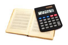 Calculator with an old book Stock Photos