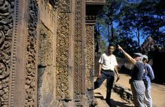 tourist visiting Angkor Wat temple Camboya - stock photo