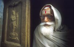 Holy man leaning out the door india Stock Photos