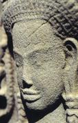 face carved in stone Angkor Wat temple Camboya - stock photo