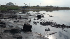 Oil pollution in Baku residential area Stock Footage