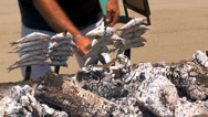 Stock Video Footage of sardines on bar-b-q at El Madero, Spanish fish food