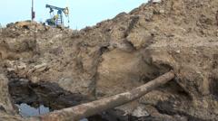 Oil pollution danger leaking pipes donkeys pumpjack Azerbaijan petroleum Stock Footage