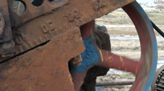 Rusty oil donkey, wheel, turning, closeup Stock Footage