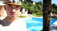 Fashionable man jumps in the pool Stock Footage