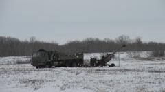 Military, artillery gun lowering elevation, long shot Stock Footage