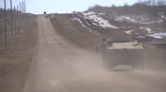 Military, US Army Humvee dusty road Stock Footage