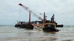 OIL SPILL DISASTER BACK HOE HYDRAULIC EXCAVATOR CRANE BARGE Stock Footage