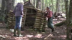 Pioneers log cabin in woods Stock Footage