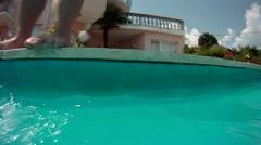 Boys are having fun Peeing in to the pool Stock Footage