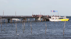 Passengers leaving ferry to pier, oyster farming in Cap Ferret Stock Footage