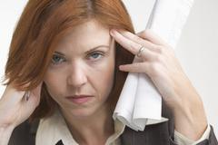 Closeup of tired business woman Stock Photos