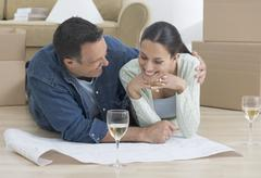 Couple looking at blueprints Stock Photos