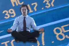 Business man meditating Stock Photos