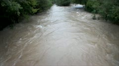 View of the increased mudy river Stock Footage