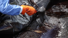 OIL SPILL DISASTER BLACK SLUDGE Stock Footage