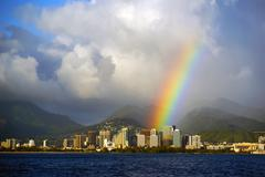Honolulu hawaii with a bright rainbow after a rain stom seen from the open oc Stock Photos
