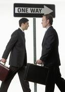 Businessmen at one way sign - stock photo