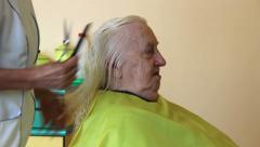 Hairdresser - old woman having her haircut. Stock Footage