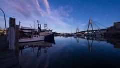 Fishing Trawlers moored next to modern bridge at sunrise 241GYDH1 PAL Stock Footage