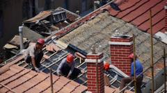 Builder repair roof under burning sun. Stock Footage