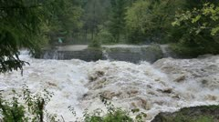 Stock Video Footage of Wiew of the increased restless river with some mist in the air