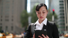 Asian business woman in New York City using ipad tablet - stock footage