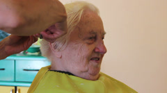 Hairdresser - old woman having her haircut 2 Stock Footage
