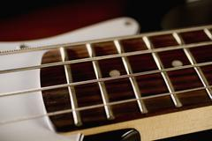 Strings on a bass guitar - stock photo