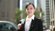 Stock Video Footage of Asian business woman in New York City smiling face