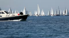 Boat gliding across the screen in the sea Stock Footage