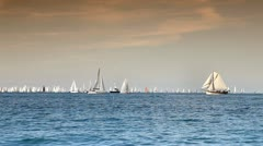 Calm sea with boats getting ready for competition Stock Footage