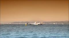 Boats in the sea at sunset Stock Footage