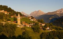 Idyllic alpine village in switzerland - evening Stock Photos